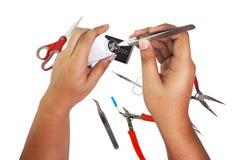 Proceso del mantenimiento del cigarrillo electrónico fotografía de archivo libre de regalías