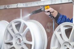 Proceso del polvo que cubre discos autos Foto de archivo libre de regalías