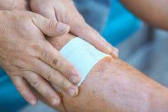 Process of applying a bandage on the injured leg. Closeup, desmurgy stock photos