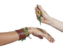 The process of applying mehendi on a woman's hand. The process of applying mehendi on the woman's hand Stock Image