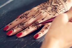 Apply Mehndi Hands : Process of applying mehndi stock image. image luck 78059079