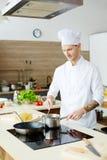 Process av matlagning arkivfoto