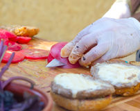 Process av matlagninghamburgaren Arkivfoto