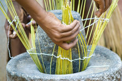 Process basketry. Close hands basket weave on stone Royalty Free Stock Image