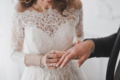 The process of betrothal of newlyweds 1219. The wife puts her husband`s wedding ring on the ring finger royalty free stock image