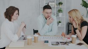 The process of brainstorming in interior design studio. Workers are intently discussing the project, communicating and royalty free illustration