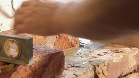Process brickwork. Showing of process brickwork . Using of level for masonry bricks stock footage