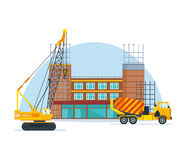 The process of building school premises with of special transport. The process of building a school premises with the help of special equipment and transport a Royalty Free Stock Photography