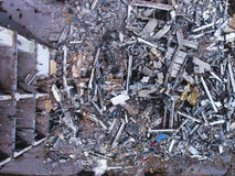 A process of buliding demolition, demolished house, shot from air with drone. A process of buliding demolition, demolition site with heavy bulldozer and Stock Photo