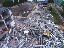 A process of buliding demolition, demolished house, shot from air with drone. A process of buliding demolition, demolition site with heavy bulldozer and Stock Image