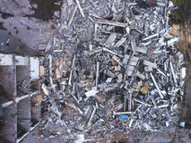 A process of buliding demolition, demolished house, shot from air with drone Stock Image