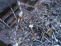 A process of buliding demolition, demolished house, shot from air with drone Stock Images