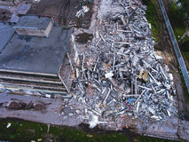 A process of buliding destruction, demolished house, shot from air with drone. A process of buliding destruction, demolition site with heavy bulldozer and Stock Photo