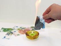 Process of burning fake euro banknotes Royalty Free Stock Photography