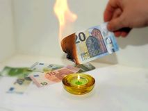 Process of burning fake euro banknotes Stock Image