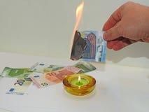 Process of burning fake euro banknotes Royalty Free Stock Photos