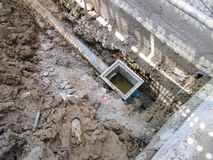 The process burying drainage pipe around the building. The process burying drainage pipe around the building, underground pipe in a job site royalty free stock images