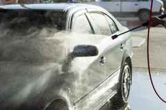 The process of car washing high pressure water Royalty Free Stock Photo