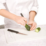 Process of carving a cucumber Stock Image