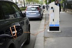The process of charging an electric car royalty free stock photo