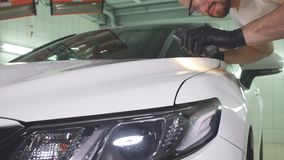 Process of checking quality of polishing of the car body. stock footage