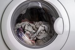 Process of cleaning color in washing machine royalty free stock images