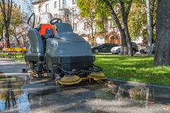 Process of cleaning walkways machine Royalty Free Stock Photography