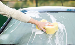 The process of cleaning the windows of the car using shampoo and Stock Photo