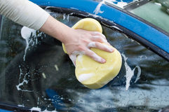 The process of cleaning the windows of the car using shampoo and Stock Images
