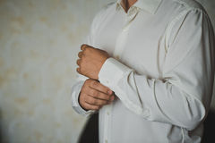 Process of clothing of cuff links  Royalty Free Stock Image