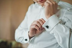 Process of clothing of cuff links on a shirt 2414. Stock Image