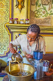 Process of coffee beans washing. KIEV, UKRAINE - JUNE 4, 2017: The Ethiopian coffee ceremony is long and difficult process, first of all - the coffee beans need Royalty Free Stock Photography