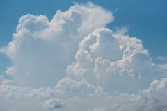A process of convective cloud from cumulus to towering cumulus and cumulonimbus cloud. In blue sky royalty free stock photography