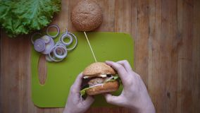 The process of cooking a burger directly above the wooden table . stock footage