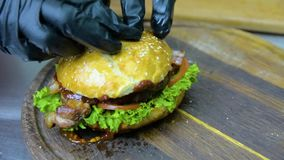 The process of cooking a burger with salad and piccul stock video