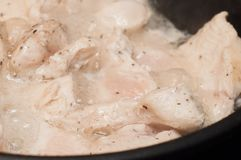 The process of cooking chicken breast diet for an athlete in a frying pan in sunflower oil. Meat for muscle recovery after royalty free stock photos