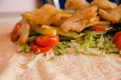 Cooking chicken wrap. The process of cooking chicken wrap on kitchen table at home concept. Homemade kebab close up. Fresh thin lavash or pita bread of shawarma stock photo
