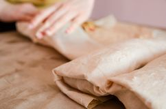 Cooking chicken wrap. The process of cooking chicken wrap on kitchen table at home concept. Homemade kebab close up. Fresh thin lavash or pita bread roll of stock images