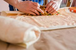 Cooking chicken wrap. The process of cooking chicken wrap on kitchen table at home concept. Homemade kebab close up. Fresh thin lavash or pita bread roll of royalty free stock photo