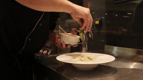 The process of cooking pasta. Cooking pasta dishes in the restaurant