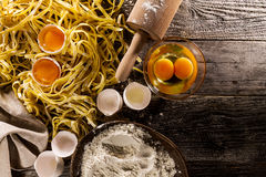 Process of cooking pasta with raw fresh ingredients for classic Royalty Free Stock Image