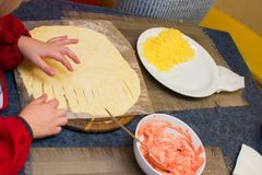 Process of cooking pizza by children in the master class Royalty Free Stock Photography