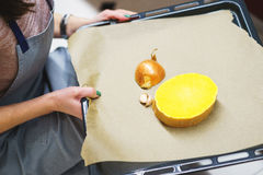 The process of cooking pumpkin for baking. Vegetables on a pan for baking. Stock Images
