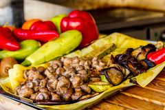 The process of cooking shish kebab on a metal grill in the open. Air.Grilling shashlik on barbecue grill. Marinated meat Royalty Free Stock Photo