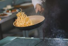 Process of cooking spaghetti Stock Photos