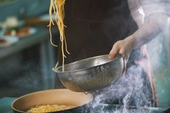 Process of cooking spaghetti in restaurant Stock Photography