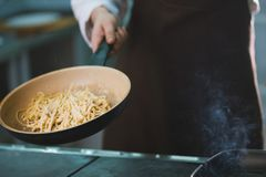 Process of cooking spaghetti with sauce Stock Photos