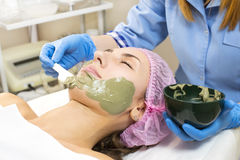 Process cosmetic mask of massage and facials. In beauty salon Royalty Free Stock Image