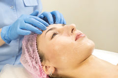 Process cosmetic mask of massage and facials. In beauty salon Royalty Free Stock Photography