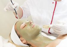Process cosmetic mask of massage and facials. In beauty salon stock photos